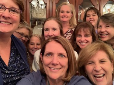 Group of nine Beta Mu alumnae squeeze in for a selfie during Night to Reunite 2019.