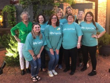 Approx 10 Birmingham alumnae pose for a photo during Night to Reunite 2019. Most are wearing the exclusive 2019 shirt.